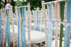 Chairs from wedding ceremony. Decorated chairs from wedding ceremony Royalty Free Stock Photos