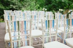 Chairs from wedding ceremony. Decorated chairs from wedding ceremony Stock Photos