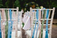 Chairs from wedding ceremony. Decorated chairs from wedding ceremony Royalty Free Stock Image