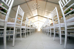 Chairs at wedding reception. Two rows of chairs at a wedding reception in a massive tent Stock Photography