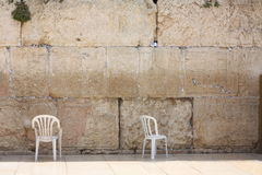Chairs at a western wall Royalty Free Stock Photography