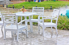 Chairs white outdoor patio Stock Images