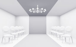 Chairs in white room. Rows of chairs in a white room with a chandelier Royalty Free Stock Image