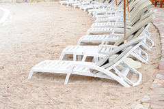 Chairs on white sand beach Royalty Free Stock Image