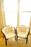 Chairs by window Royalty Free Stock Photography