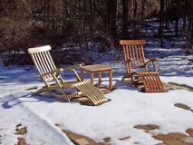 Chairs in winter. Two chairs in early winter snow royalty free stock photo