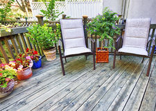Chairs on wooden deck royalty free stock image
