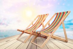 Wooden chaise longue chairs on tropical beack stock images