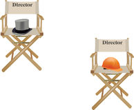 Chairs with writing director. Canvas chair with hat and written director Stock Images