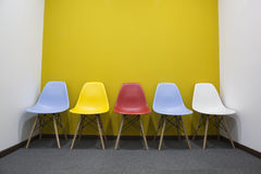 Chairs with yellow wall in office. stock photography