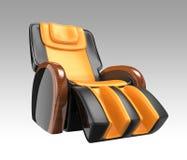 Chaise étendue en cuir noire et jaune de massage. Image stock