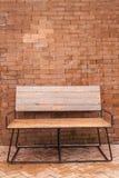 Chaise avec le fond de brique Photographie stock