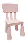 Chaise en plastique ou selles d'enfants roses Image libre de droits