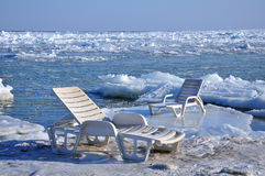 Chaise longue. On the shore of a frozen sea royalty free stock photo
