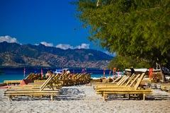 Chaise-longue at the beach. Travangan gili royalty free stock photos
