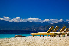 Chaise-longue at the beach. Travangan gili stock image