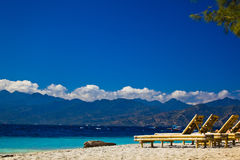 Chaise-longue at the beach. Travangan gili royalty free stock images