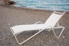 Chaise-longue on the beach. White chaise-longue on the sea beach stock photos