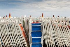 Chaise longue closed in a Italian beach Royalty Free Stock Images
