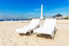 Chaise longue on Copacabana beach in Rio de Janeiro Stock Photo
