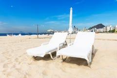 Chaise longue on Copacabana beach in Rio de Janeiro Stock Photo