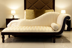 Chaise Longue. Cream Chaise Longue in Bedroom Royalty Free Stock Image
