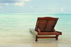 Chaise longue nell'acqua Fotografia Stock Libera da Diritti