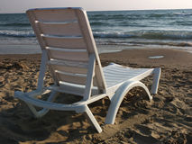 Chaise longue. And the sea stock photography