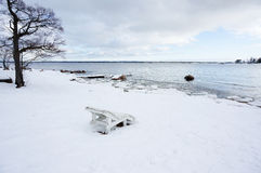 Chaise longue on the snowed beach Royalty Free Stock Photos