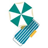 Chaise longue and umbrella Stock Photo