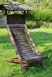 Chaise longue. From wood on meadow stock photos