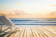 Chaise longue wooden floor seaside. Chaise longue on wooden floor at the seaside. 3D Rendering royalty free stock images