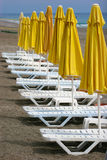 Chaise-longues. On the beach royalty free stock photo
