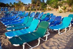 Chaise-longues on beach. Blue chaise-longues on caribbean beach royalty free stock photos