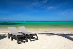 Chaise-longues on beach Stock Photos