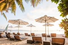 Chaise longues at the beach on the Boracay island, Philippines.  stock photos