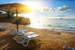 Chaise-longues on a beach Stock Image