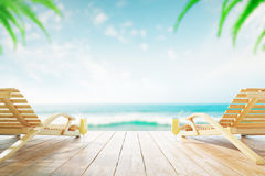 Chaise longues with cocktails Stock Image