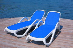 Chaise longues on the deck pier Stock Photo