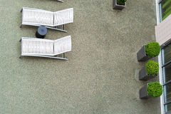 Chaise-longues. Empty chaise-longues near swimming pool royalty free stock photography