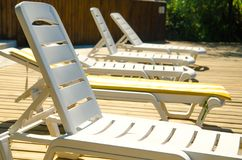 Chaise-longues in hotel. Near pool royalty free stock photo