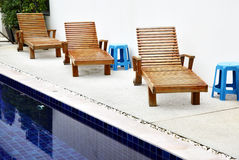 Chaise longues near pool Royalty Free Stock Photo