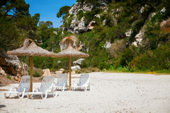 Chaise longues at sandy beach Royalty Free Stock Photography