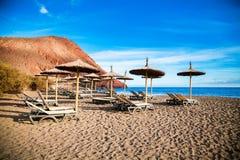 Chaise-longues and sun umbrellas in Playa de la Tejita Stock Photos