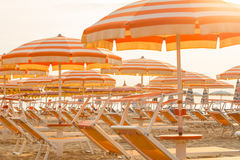 Chaise longues and umbrellas on a  beach Royalty Free Stock Image