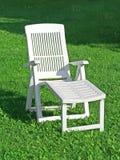 Chaise lounge. In garden stock photos