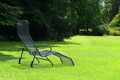 Chaise lounge. On the green grass stock images