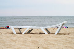 Chaise lounge. On a beach royalty free stock photography