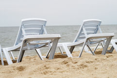 Chaise lounge. On a beach stock images