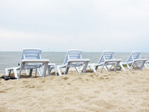 Chaise lounge. On a beach stock image